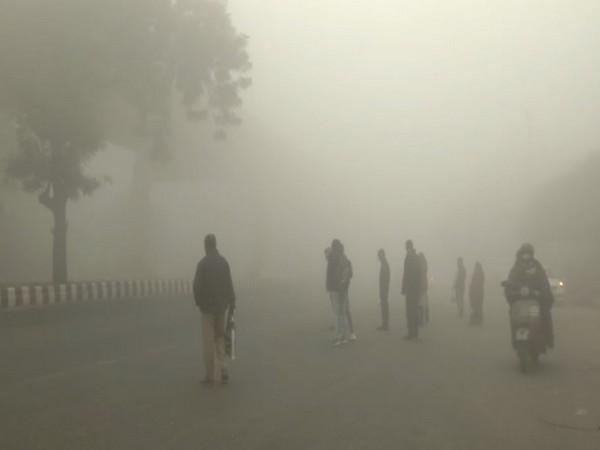 A layer of dense fog covered the Vasant Vihar area in Delhi on Monday morning (Photo/ANI)