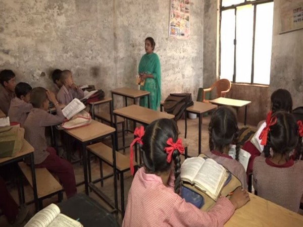 Kavita Devi, daughter of a laborer teaches students coming from financially weaker section in Government Middle School, amid a dire shortage of teaching staff. (Photo/ANI)