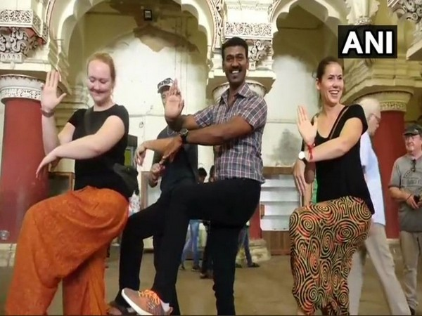 Nagendra Prabhu, tourist guide explains the aspects of Tamil culture to tourists through Bharatanatyam dance form. Photo/ANI
