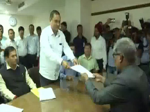 BJP's Kamakhya Tasa handing over his Rajya Sabha nomination papers to the Returning Officer in Guwahati, Assam on Tuesday. (Photo/ANI)