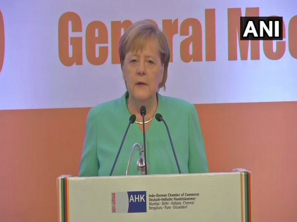 German Chancellor Angela Merkel addressing the gathering at a business meeting in New Delhi (Photo/ANI)