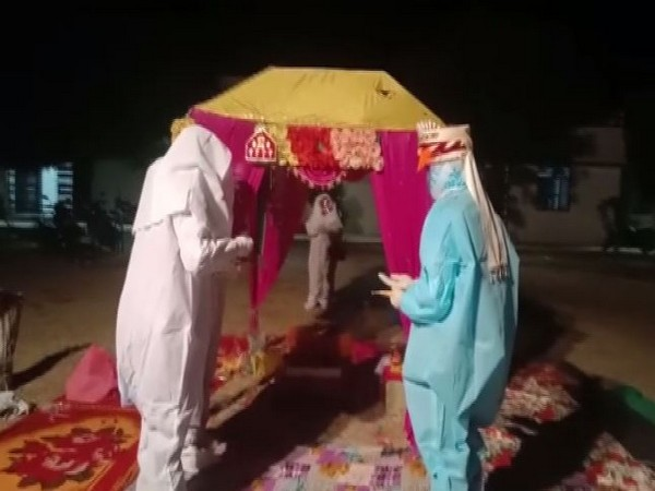 COuple tied the knot wearing PPE kits in Rajasthan's Bara (Photo/ANI)