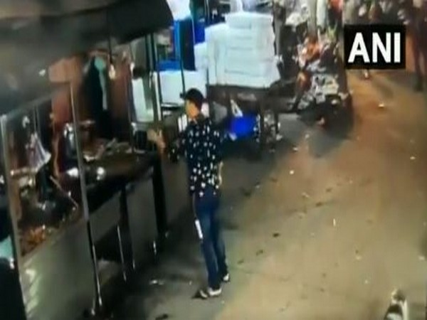 The accused was caught on camera brandishing a knife and vandalizing shops in East Delhi's Welcome area. Photo/ANI