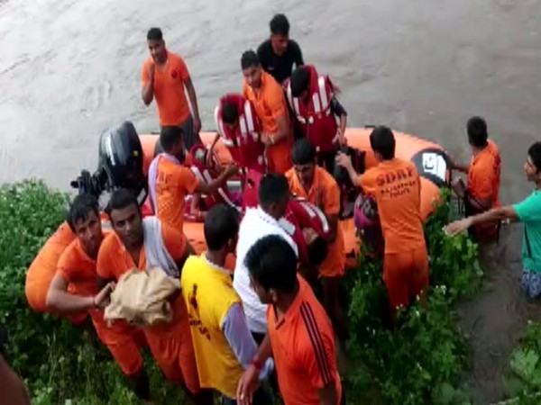 SDRF team rescued locals who were stranded in the flood-affected areas in Pratapgarh, Rajasthan. (Photo/ANI)