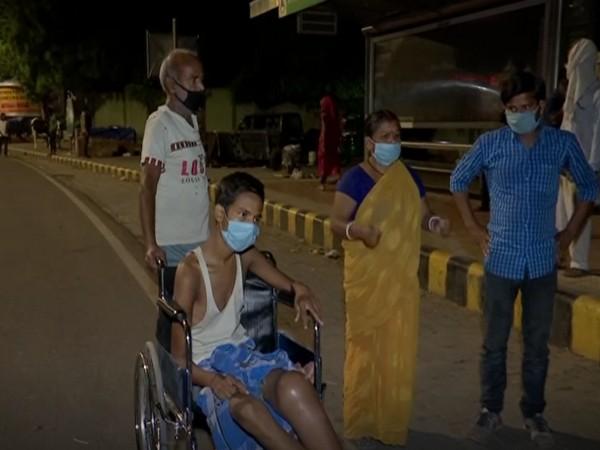 Rani Devi along with her family members outside Delhi's AIIMS Hospital (Photo/ANI)