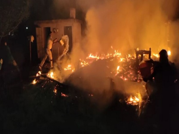 People try to douse fire at a house in North 24 Parganas