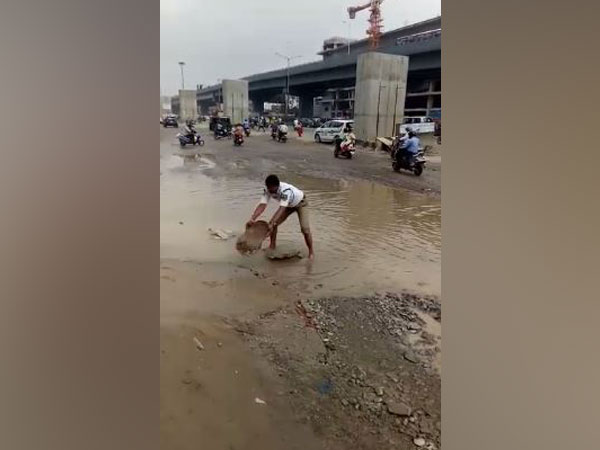 Nagamallu, a traffic inspector diverted water from LG Nagar area to make way for the commuters and vehicles (Photo/ANI)