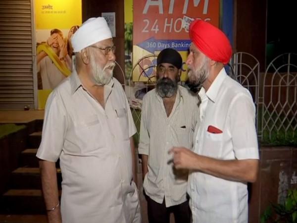 Sikh community people waiting outside the Maharashtra Co-operative (PMC) Bank on Tuesday. Photo/ANI