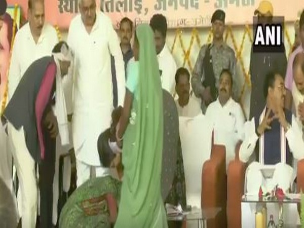 A woman on Saturday fell at the feet of Union Minister Smriti Irani during her visit to Amethi, seeking help in land grabbing case. Photo/ANI