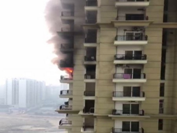 A massive fire broke out in an apartment in Apex Athena society in sector 75 on Friday (Photo/ANI)