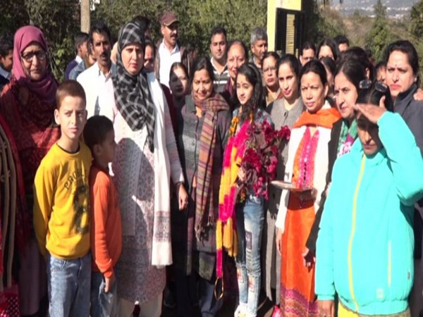Khushi with her family and teachers in Kawa, J&K, after winning the first prize in Solo Vocal Music Category at the National Level Kala Utsav Competition.