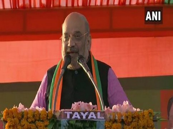 Home Minister Amit Shah while addressing a public rally at Chhatarpur in New Delhi on Thursday. Photo/ANI