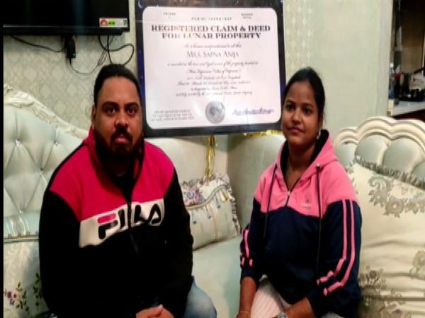 Dharmendra Anija and Sapna Anija with framed certificate of the property document (Photo/ANI)