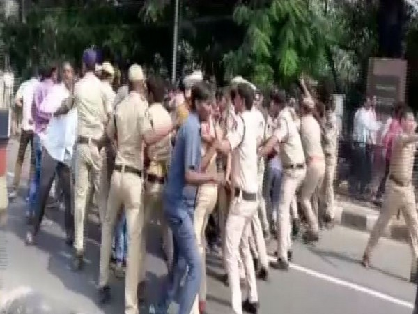 Police personnel trying to control and disperse crowd (Photo/ANI)