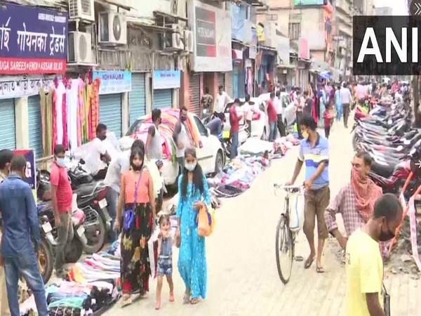 People shopping at a Guwahati market (Photo/ANI)