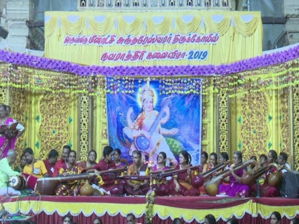 As many as 108 women of different age groups filled the air with music at Meenakshi Amman Temple in Madurai on the occasion of Vijaya Dashami. (Photo/ANI)