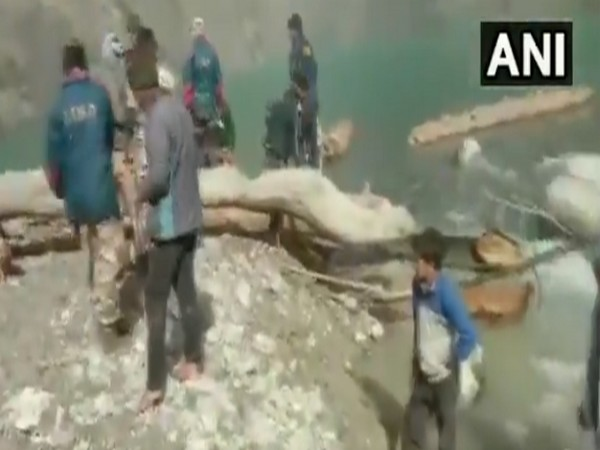 ITBP, along with SDRF, removes trees and boulders from an artificial lake in Chamoli