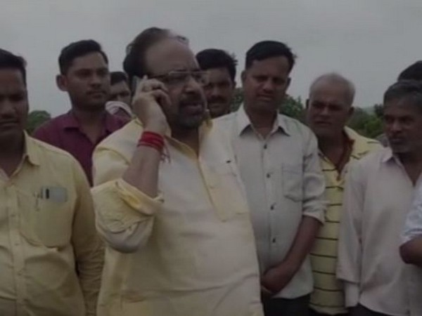 BJP leader Gopal Bhargava talking to the officials on Monday. Photo/ANI