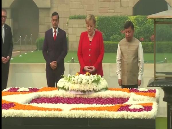 German Chancellor Angela Merkel at Rajghat