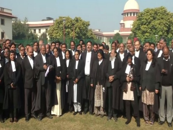 Supreme Court advocates singing the National Song in the court's law on Friday (Photo/ANI)