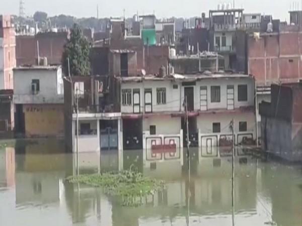 Submerged houses on the bank of River Ganga in Prayagraj. (Photo/ANI)