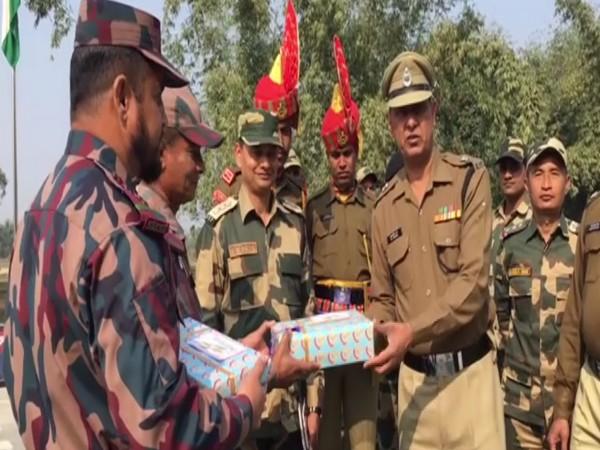 Border Security Forces (BSF) on Sunday exchanged sweets with Border Guards of Bangladesh (BGB) at Fulbari crossing at Indo-Bangladesh border