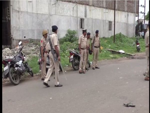 Police keeping a vigil in the Bamroli industrial area on Friday. Photo/ANI
