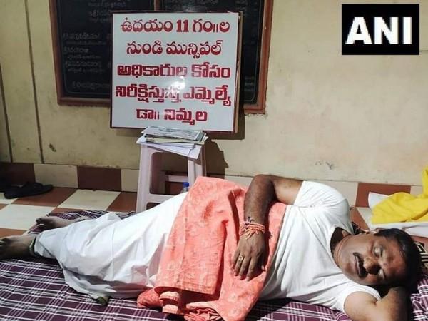 TDP MLA Nimmala Rama Naidu slept outside Municipal Commissioner's Office in Palakollu town. (Photo/ANI)