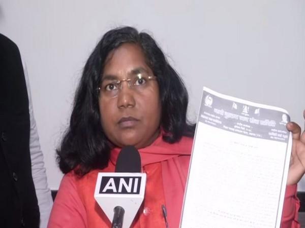 Savitri Bai Phule showing her resignation letter on Thursday (Photo/ANI)