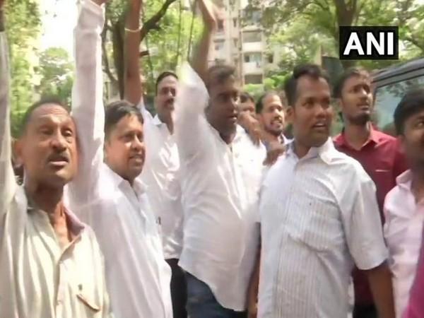 NCP workers raise slogans against Ajit Pawar in Mumbai on Saturday. Photo/ANI