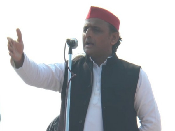 Samajwadi Party chief Akhilesh Yadav addressing a gathering at Republic Day event in Saifai, Uttar Pradesh on Sunday. (Photo/ANI)