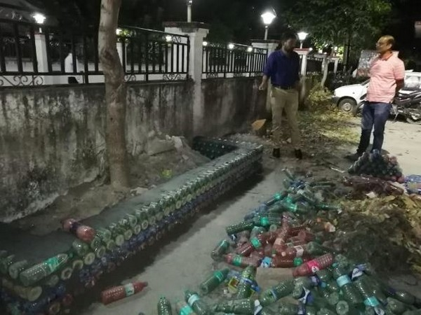 Uttarkashi DM, Dr Ashish Chauhan takes initiative to dispose of plastic bottles by constructing a model using empty bottles. (Photo/ANI)