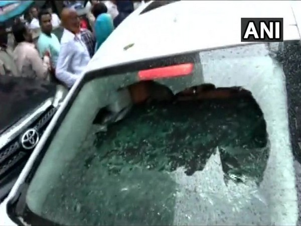 BJP candidate Parag Shah's car was vandalized by supporters of Prakash Mehta on Friday. Photo/ANI
