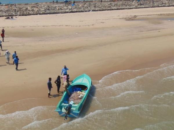 A Srilankan boat intercepted by Navy helicopter in Dhanushkodi (Photo/ANI)