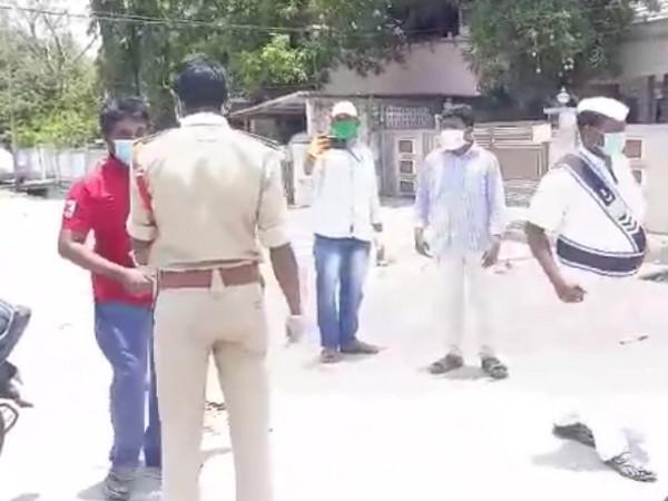 Police enquiring the lockdown violators in Krishna District (Photo/ANI)
