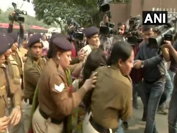 Police personnel take the woman from outside Safdarjung Hospital (Photo/ANI)