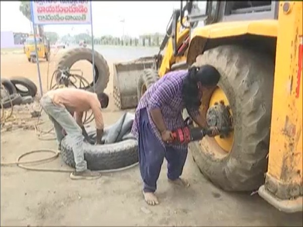 Adilaxmi, Telangana's first woman mechanic working with her husband in their automobile repair. (Photo/ANI)