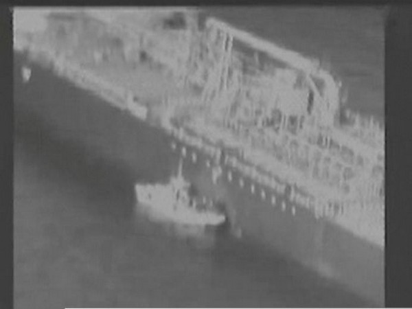 Still image taken from a US military handout video purports to show IRGC removing an unexploded limpet mine from the side of the Kokuka Courageous Tanker  (Reuters)