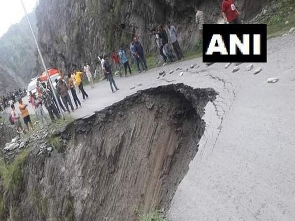 Buses got stuck in Chamba, Himachal Pradesh after a road got wahsed away following heavy downpour on Tuesday. (Photo/ANI)