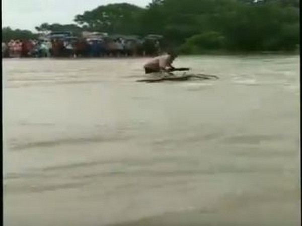 Man washed away while crossing a flooded river in Rajgarh on Thursday. [Photo/ANI]