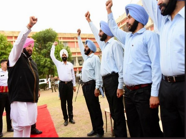 Punjab Chief Minister Captain Amarinder Singh with the Sikh Regiment staff on Saturday evening. Photo/ANI