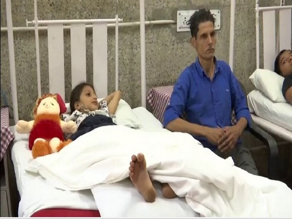 The girl with her father after being treated of snake bite at Army Hospital in Srinagar. Photo/ANI