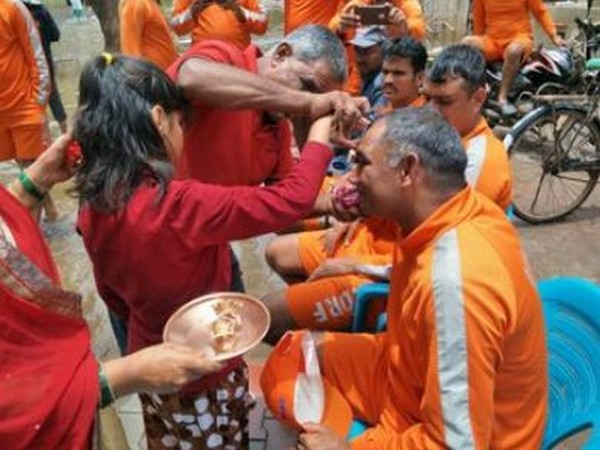 Women and girls tied Rakhis on the wrists of NDRF personnel in Maharashtra's flood-affected district Sangli. (Photo/ANI)