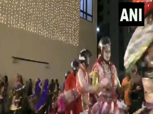 Dance group from a 'garba class' in Surat performs wearing helmets in a bid to promote awareness about usage of helmets