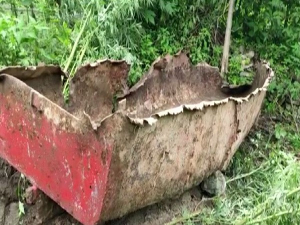 Residents of Nizamula village recover a boat from Durmi lake in Chamoli which was wreacked and