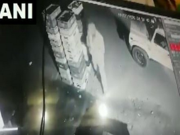 Policeman stole milk packets in Noida on Monday (Photo/CCTV Footage)