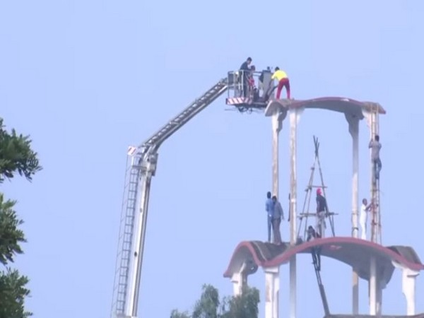 Fire tenders rescued a stranded man with the help of sky lift machine in Bhubaneswar (Photo/ANI)