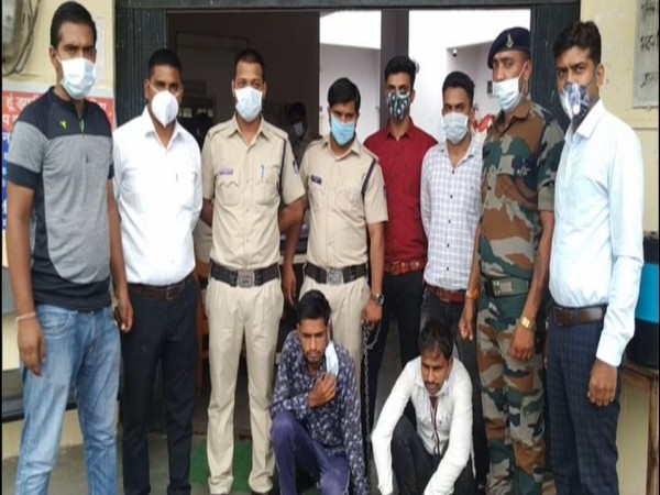 Police officers with the two accused in Shajapur.