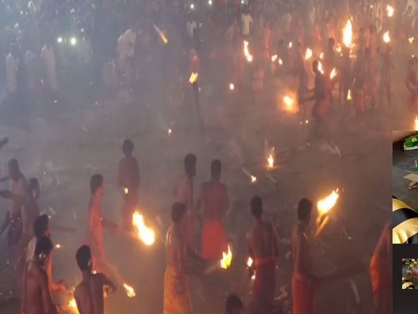 Devotees from Athoor and Kodathoor villages throw fire torches at each other. Photo/ANI