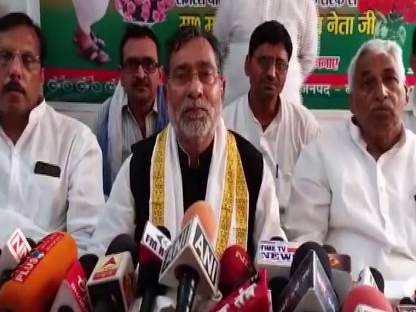 Samajwadi Party (SP) leader Ram Govind Chaudhary speaking to media persons in Ballia on Friday. Photo/ANI
